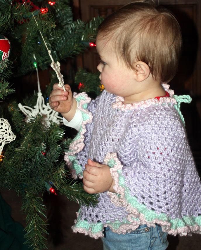 Amelia checking out a Christmas tree ornament