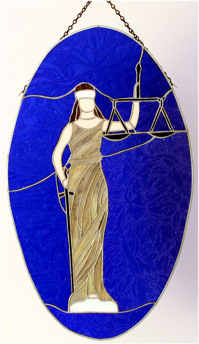 stained glass panel of the lady of justice